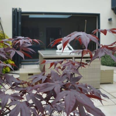 Power screens allow you to enjoy this beautiful garden without the distraction of insects