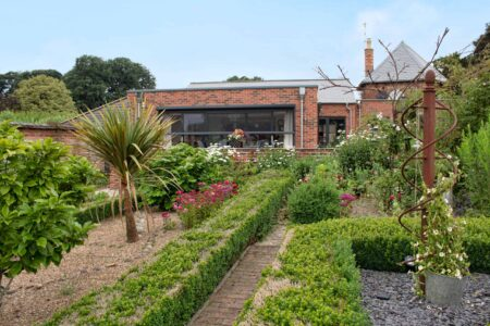 Walled garden with automated screens for large doors
