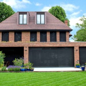 Full width image of rear of property with large power screens