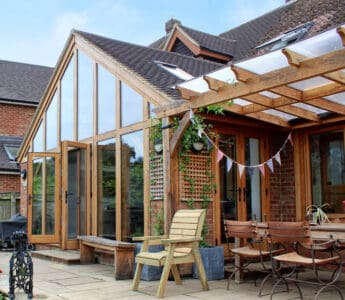 Fly screens for doors on oak frame extension with doors open