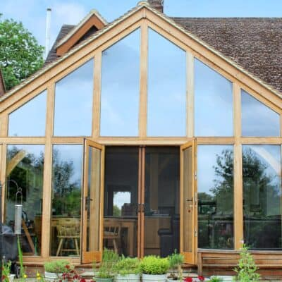 Oak framed extension with manual fly screens for doors