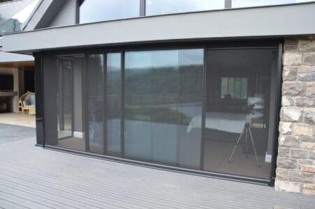 Large power screen door over patio doors