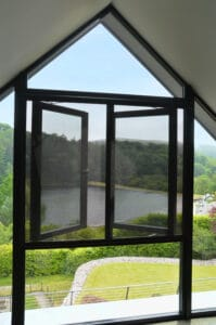 Window fly screens with spectacular lake view