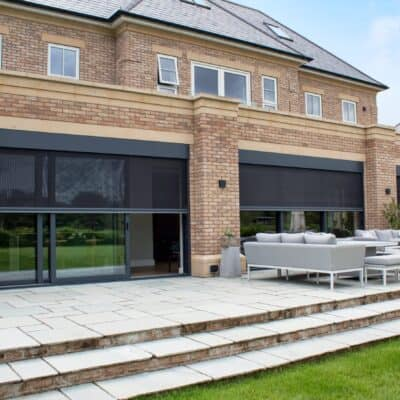 Automated power screens for large glass sliding doors