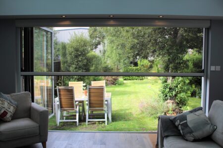 Enjoy the outdoor dining with a power screen
